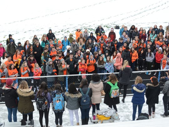 South Burlington students gathered to mark the 19th anniversary of the Columbine shooting on April 20, 2018, on the athletic field behind South Burlington High School.