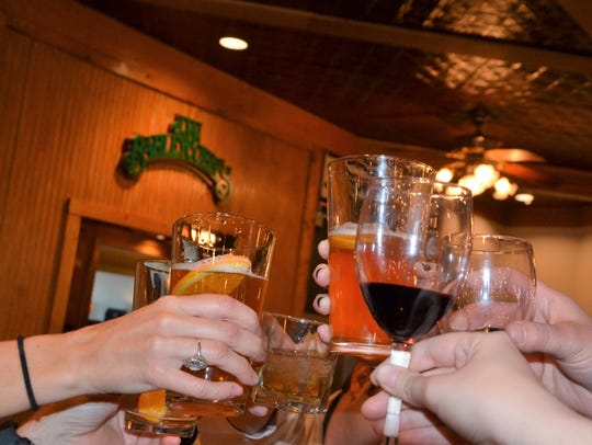 Cheers at J.W. Barleycorn, located at 50 Capital Avenue