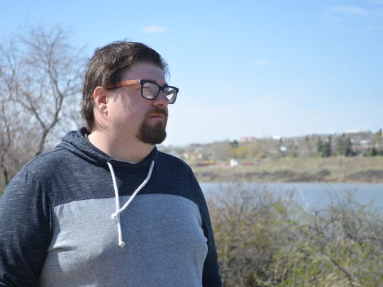Tommy Roberts looks over the Missouri River from the caboose area on River's Edge Trail, where his daughter Brittney was first reportedly seen in the river.