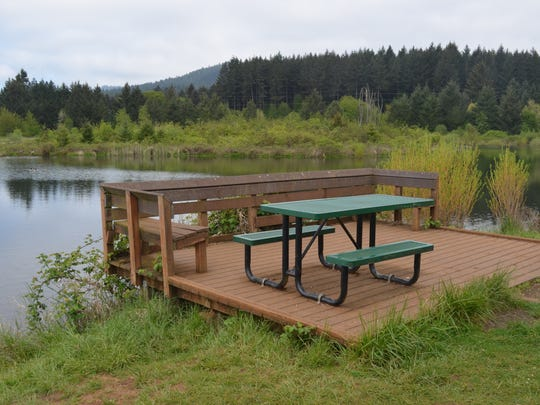 Picnic tables and an accessible fishing platform are just some of the attractions at Adair Pond north of Corvallis.
