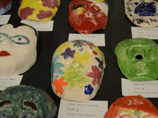 Some of the ornamental masks on display during the arts event at Bearden Middle School.