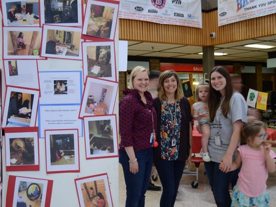 Art instructor Jessie Winston, French teachers Florence Fillers and Megan Haniford and Haniford's children took part in the Night of the Arts event at Bearden Middle School on May 10.