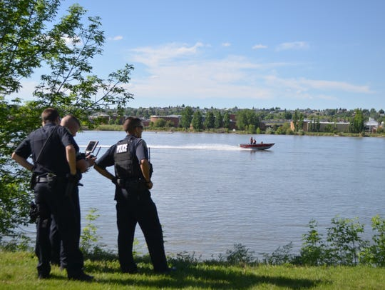 A search and rescue boat angles toward GFPD's drone used to find a man's body floating in the Missouri River on May 25, 2018.