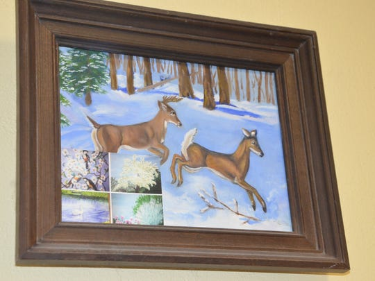 A painting by Richie Hess hangs in the office of Debra Coller, resident care specialist at Kambly Living Center.
