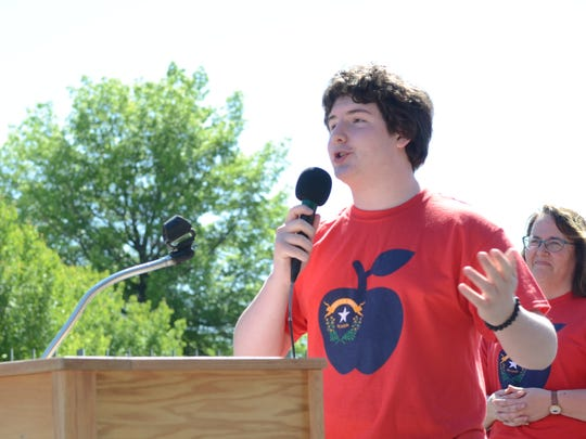 Nathan Noble, 15, speaks at an rally about the importance