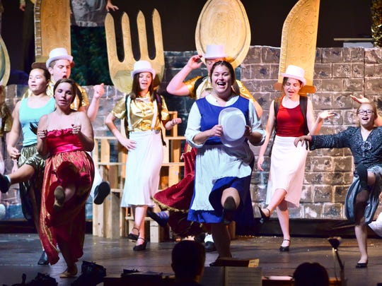 "Sydney Schibbelhut, playing ""Belle"" dances amongst ensemble members during ""Be Out Guest"" at rehearsal for the Fond du Lac Community Theatre's summer production of ""Beauty and the Beast."""
