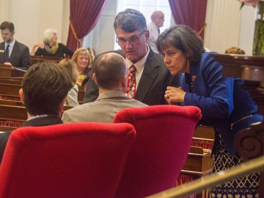 House Speaker Mitzi Johnson, D-South Hero, right, and Minority Leader Don Turner, R-Milton, consult with House Clerk William MaGill in advance of tax and budget debate on Monday, June 25, 20118 at the Statehouse in Montpelier.