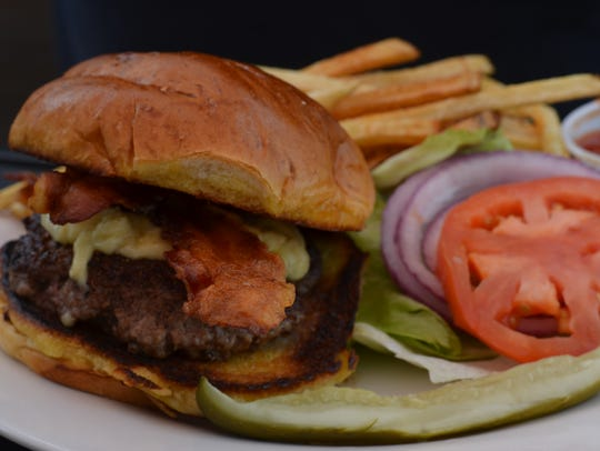 A burger at Wildseed in Strafford shares space on the