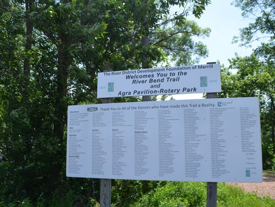 A sign at the River Bend Trail welcoming visiting and