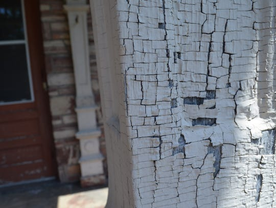 Paint chipping on the T.B. Scott Mansion in Merrill.