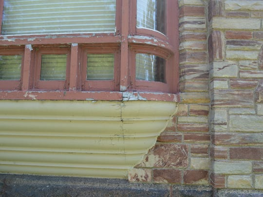 A section on a window of the T.B. Scott Mansion in