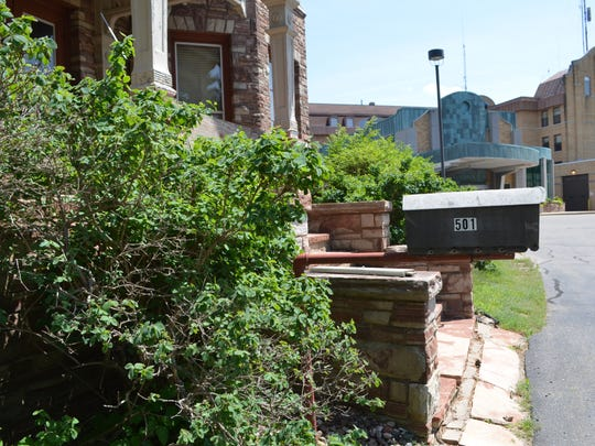 The mailbox at the T.B. Scott Mansion with Ascension Good Samaritan Hospital in the background.