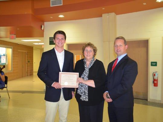 Left to right: Luke Schraer, Ridge High School student