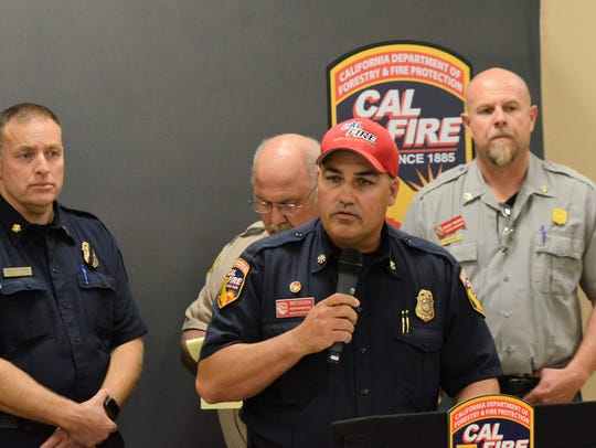 Bret Gouvea, Cal Fire incident Commander for the Carr Fire briefs the media during the 1:00 p.m. press conference at the Shasta District Fair & Event Center on July 28, 2018.
