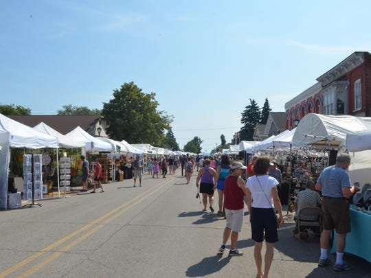 People pack downtown Lexington during the Lexington Fine Arts Fair on Aug. 5, 2018, in Lexington, Michigan.
