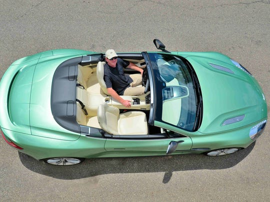 In the lap of luxury; the 2014 Aston Martin Vanquish Volante offers style and exclusivity for $320,000.