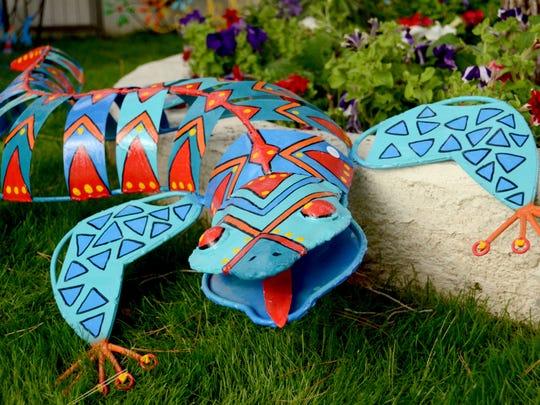 A lizard sculpture by artist Constance Adams, of Colors