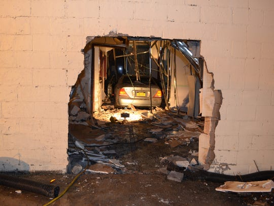 Hole in rear of the former Spring Valley Flea Market left after a car driven by Shannnon Stanislas, 25, rammed the building and ended up inside, Dec. 6, 2014.