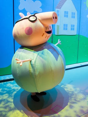 """Former WLNS anchor Evan Pinsonnault as Daddy Pig in the touring production of the hit children's show """"Peppa Pig."""""""