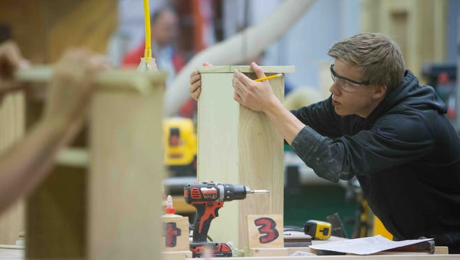Trey Banning, 17, a senior at Sussex Tech works on his cabinet as students from the state of Delaware compete in a cabinetmaking competition at Delcastle Technical High School as part of SkillsUSA.
