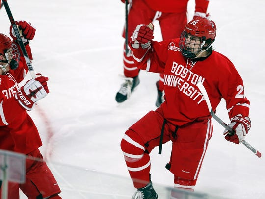 Brady Tkachuk (left) celebrates a goal with Boston teammate David Farrance during the NCAA college hockey tournament in Worcester, Mass., in March.