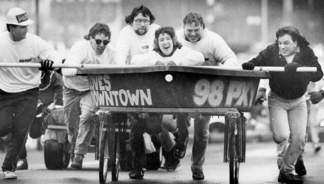 The 98 PXY Bed and Bathtub race entry with Scott Spezzano, right, on Exchange during the I Love Downtown festivities held in February 1988.