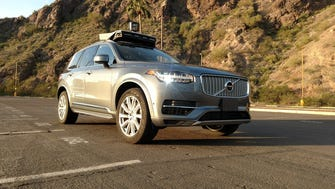 A handout photo from Uber shows one of its Volvo self-driving SUVs in a desert setting. One of the company's vehicles struck and killed a pedestrian in Tempe, Ariz., Sunday night.