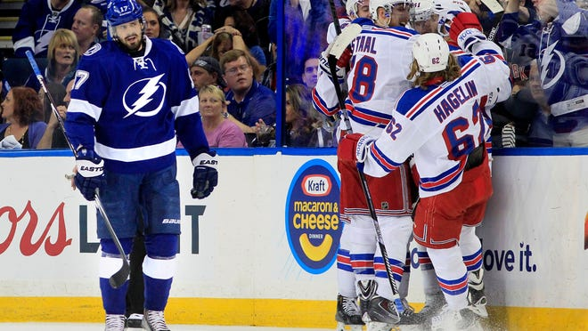 Tampa Bay Lightning center Alex Killorn (17) skates off as the New York Rangers celebrate the first goal of the game scored by Rick Nash (61) during the first period in Game 4 of the NHL hockey Stanley Cup Eastern Conference finals.