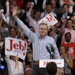 Jeb Bush waves before announcing his bid for the Republican presidential nomination Monay at Miami Dade College.