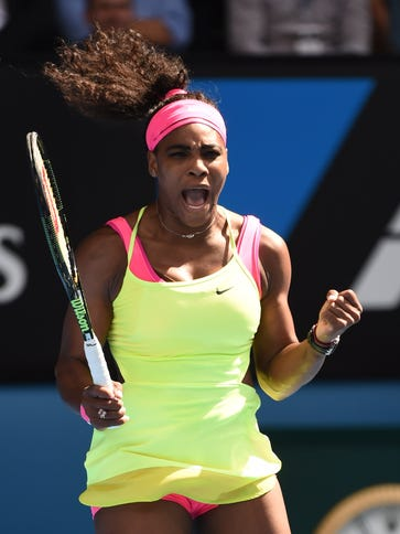 Serena Williams celebrates winning a point during her