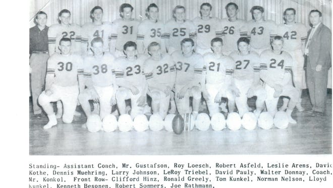Here's a yearbook photo of the 1956 Kimball football team that went 8-0 and outscored its opponents 293-0.