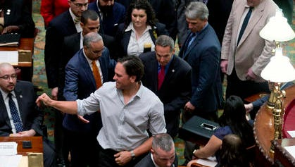 Baseball Hall of Fame elected Mike Piazza waves as he walks in the Senate Chamber at the Capitol on Wednesday, March 9, 2016.
