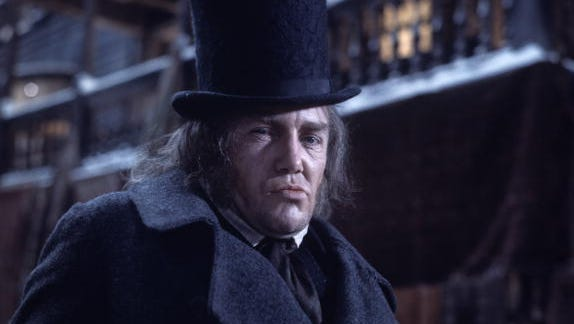 """Albert Finney as Ebenezer Scrooge in the 1970 film musical """"Scrooge,"""", adapted from the novel """"A Christmas Carol"""" by Charles Dickens."""