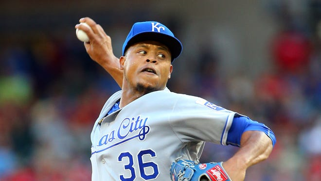 Edinson Volquez of the Kansas City Royals throws in the first inning against the Texas Rangers at Globe Life Park in Arlington on July 29, 2016 in Arlington, Texas.