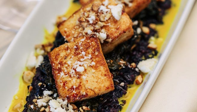 Chili glazed tofu with black rice, kale, candied peanuts at answer.