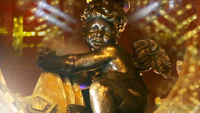 Photo Illustration: The famous holiday cherub magically arrived atop the Ayres Clock on the corner of the Carson Pirie Scott Department Store in Downtown Indianapolis on Wednesday, Nov. 22, 2017.