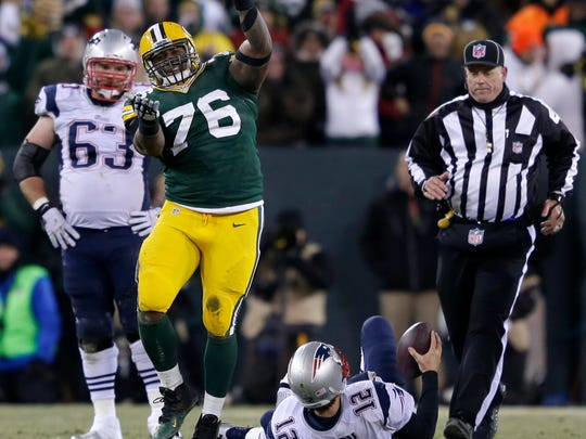 Green Bay Packers defensive tackle Mike Daniels celebrates after sacking New England Patriots quarterback Tom Brady late in the fourth quarter at Lambeau Field.