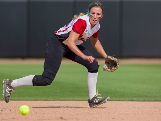 New Palestine High School senior shortstop Ashley Prange (29) fields a ground ball hit her way during the 34th Annual IHSAA Softball State Finals class 3A game, Saturday, June 9, 2018, at Bittinger Stadium on the campus of Purdue University, West Lafayette. New Palestine High School won over South Bend St. Joseph High School 3-1.