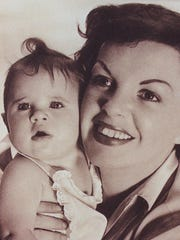 The legendary Judy Garland is shown with her daughter