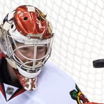Blackhawks rally from 3 down in 3rd, beat Canucks in OT