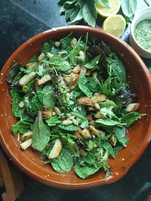 This easy, healthful salad features cannellini beans and greens tossed in a zesty lemon-basil pesto. Everything bagel croutons add crunch.