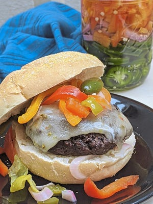 Sweet and spicy pickled peppers add color and a bit of heat to a grilled burger.