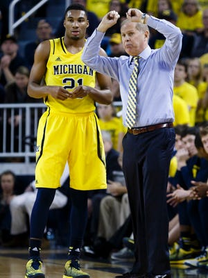 Michigan basketball coach John Beilein talks to guard/forward Zak Irvin (21) in the second half against the Hillsdale Chargers at the Crisler Center.