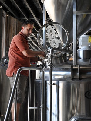 Matt Bitsche, president and head brewer, looks over some of the recently-installed equipment at Wichita Falls Brewing Company, an endeavor he and his business partner, Russ Reynolds, began in December of 2016.