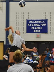 Sam McKenna participates in volleyball practice at