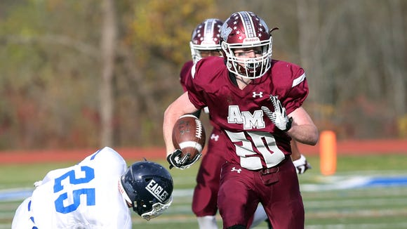 Albertus Magnus' Aidan Condon (20) looks for some running