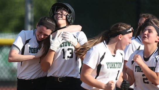 Yorktown's  Brianna Buck (13) is mobbed by teammates