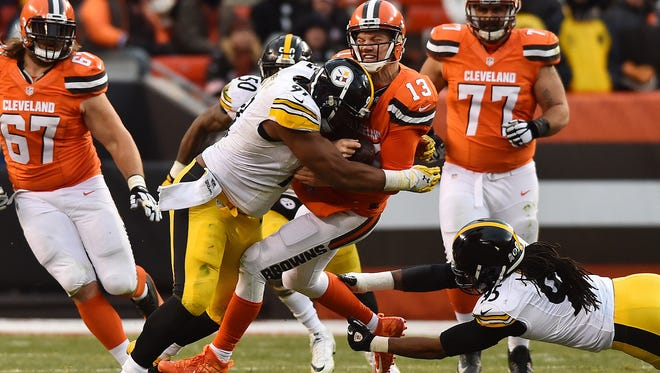 Cleveland Browns quarterback Josh McCown (13) is tackled by Pittsburgh Steelers defensive end Stephon Tuitt (91) during the second half at FirstEnergy Stadium. The Steelers won 24-9.