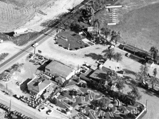 Aerial view shows the Tom Thumb Golf Course and driving range at Little America at Keystone Ave., and 62nd street in 1957. Construction of Glendale Mall can be seen in the top left-hand corner.