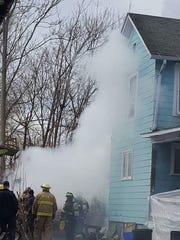 Two were treated for injuries after a garage fire broke out on Sunday.